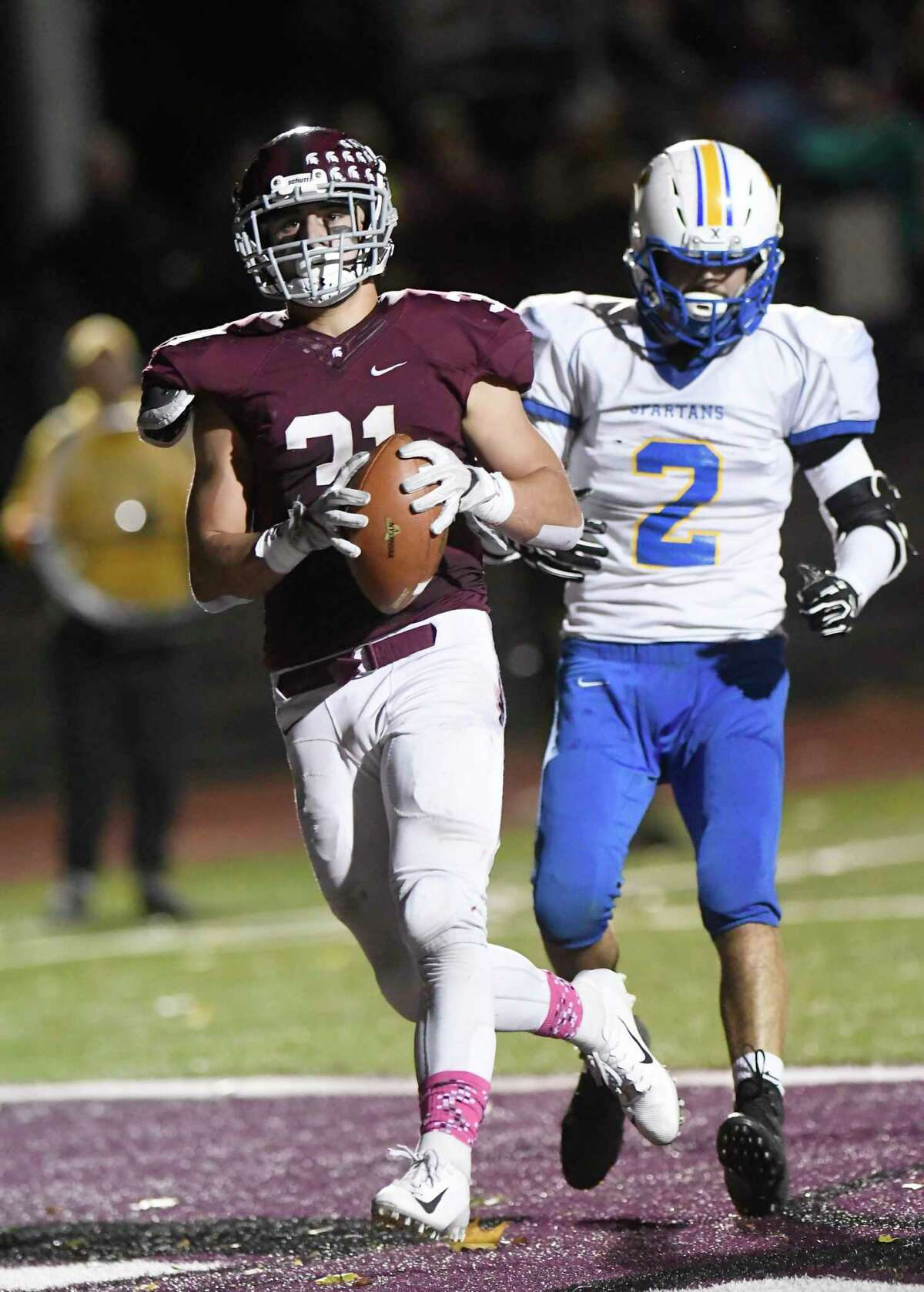 Burnt Hills-Ballston Lakes Vincent Daviero (31) scores a touchdown in front of Queensburys Zaki Farah (2) during the first half of a Section II High School football game Friday, Oct. 12, 2018, in Burnt Hills, N.Y. (Hans Pennink / Special to the Times Union)