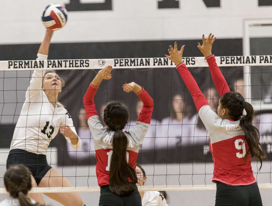 Hanna Hetherington (13) spikes the ball Friday night at Permian Field House. Photo: Jacy Lewis/191 News