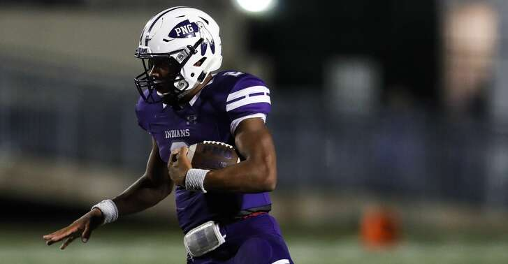 Port Neches-Groves quarterback Roschon Johnson (2) breaks away from Crosby linebacker Hunter Houser (8) on a run during the first quarter of a Class 5A bi-district playoff football game at Stallworth Stadium on Friday, Nov. 17, 2017, in Baytown. ( Brett Coomer / Houston Chronicle )
