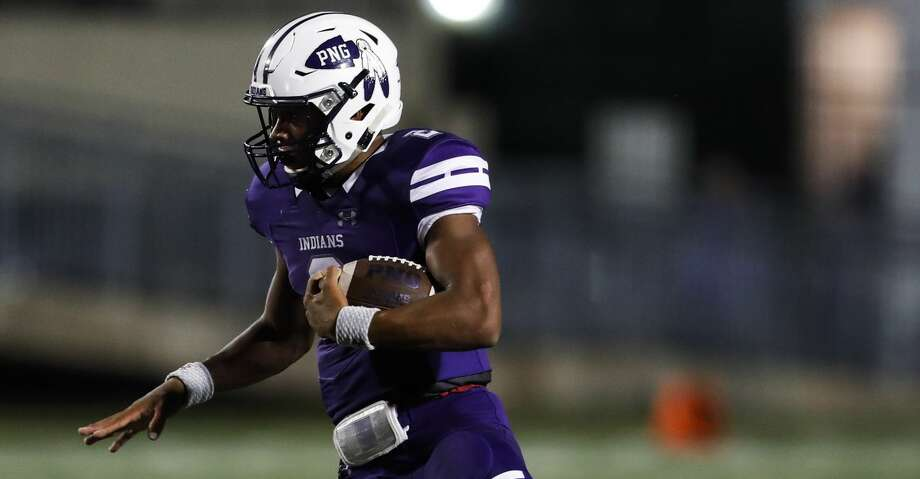 Port Neches-Groves quarterback Roschon Johnson (2) breaks away from Crosby linebacker Hunter Houser (8) on a run during the first quarter of a Class 5A bi-district playoff football game at Stallworth Stadium on Friday, Nov. 17, 2017, in Baytown. ( Brett Coomer / Houston Chronicle ) Photo: Brett Coomer/Houston Chronicle