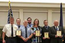 Recently recognized as the 2018 Carl and Esther Gerstacker Police and Firefighters of the Year are, in front, from left: Jerome Township Fire Department firefighters Bobby Bailey and Bob Bailey, Midland County Sheriff Deputy Ann Gaydos, Midland Fire Department Firefighter Jim Daveluy and Midland Police Officer John Dubois. In back, from left: Jerome Township Fire Department Battalion ChiefJim Bailey and Firefighter Paul Bailey.(photo provided)