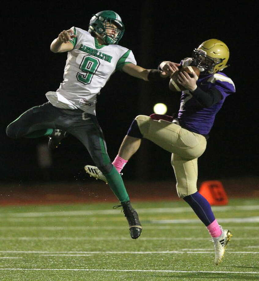 Routt's Cole Evans intercepts a pass during a high school football game against Carrollton in Jacksonville Friday night. Carrollton's Byron Holmes carries a Routt tackler during a game Friday night. Photo: Dennis Mathes   Journal-Courier