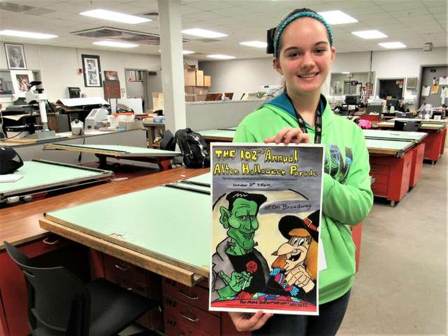 Alton High School student Olivia Joiner was named winner of the Alton-East End Improvement Association's annual Alton Halloween Parade poster contest, chosen by the association's parade committee last week ahead of the Oct. 31 parade. The freshman's drawing ability brought detail to the poster, as she free-handed the design before using newly-acquired photo editing to techniques to digitally enhance the work. Frankenstein, a witch, a moon, a night sky and Halloween candy along with textual elements took a little over a month for Joiner to illustrate. Photo: Photos By Brittany Johnson | The Telegraph