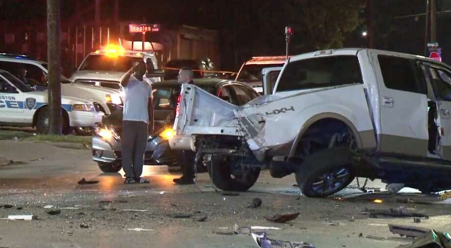 Two men in a white pickup were speeding westbound on Liberty about 10:30 p.m. Friday, Houston police said, when they slammed into the back of a Lincoln car stopped at a red light at Bringhurst, sending the car head-on into an oncoming truck. The white pickup then slammed into the back of a second car, and was clipped by a third car southbound on Bringhurst with a green light. The white pickup's passenger died at the scene and driver was taken to a hospital in critical condition. Photo: Metro Video