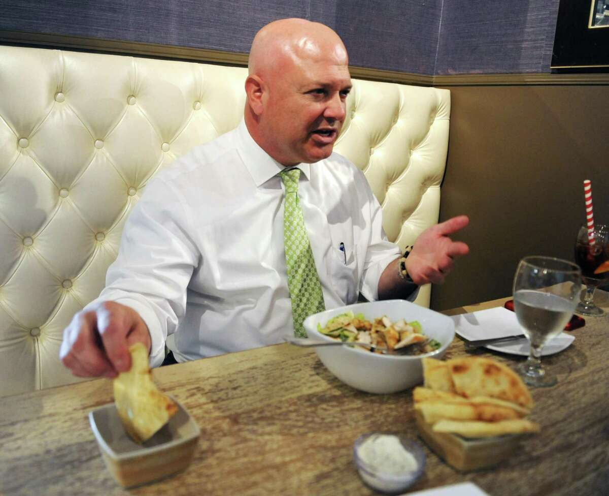 State Rep. Mike Bocchino, R-Greenwich, uses a pita to demonstrate where funds for a lockbox are distributed during lunch at Famous Greek Kitchen in the Byram section of Greenwich, Conn. Wednesday, Oct. 3, 2018. Bocchino has been representing Connecticut's 150th District since 2015 and is up for re-election against Democrat Steve Meskers.