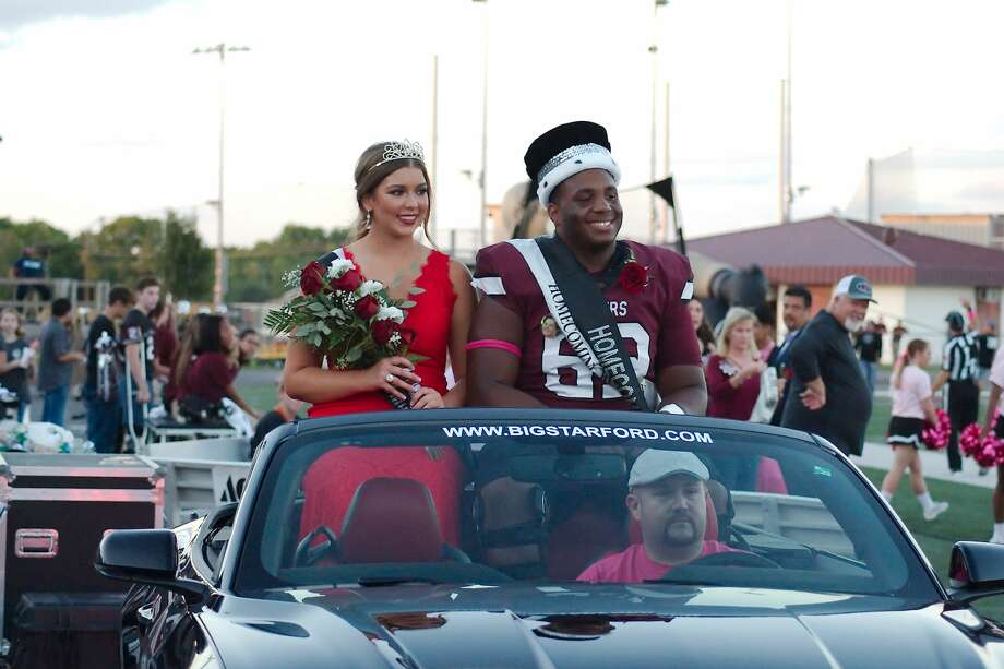 Maddie Dies and Sincere Haynesworth are crowned queen and king during the Pearland High School homecoming football game against Elsik at Pearland High School. Photo: Kirk Sides/Houston Chronicle