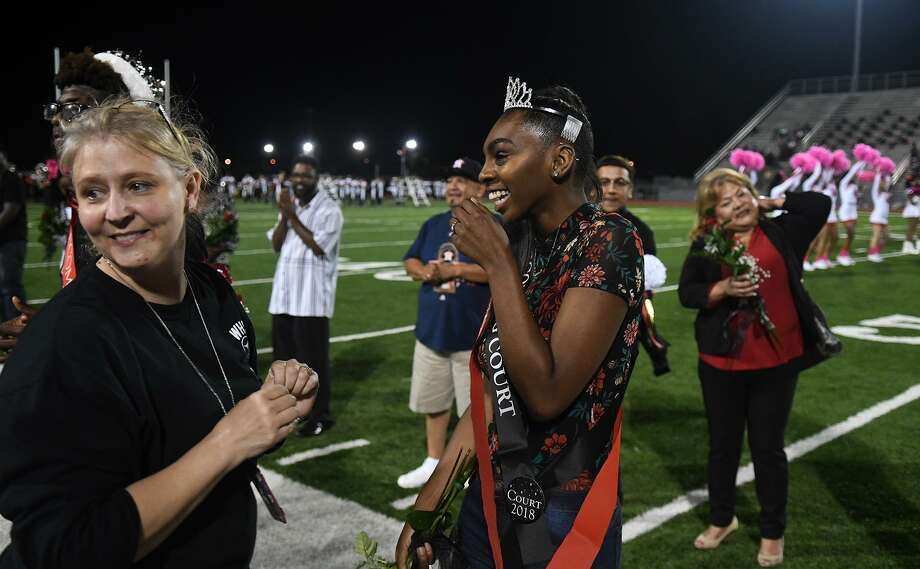 Westfield High School senior Marcahye Davis, right, gets emotional after being crowned as the 2018 WHS Homecoming Queen by Student Council Sponsor Lisa Batten, left, at halftime of the Mustang's District 16-6A football matchup at Leonard George Stadium in Spring on Oct. 12, 2018. Photo: Jerry Baker, Houston Chronicle / Contributor / Houston Chronicle