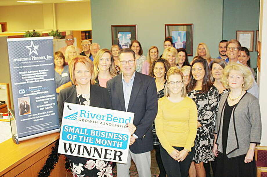 RiverBend Growth Association ambassadors and Investment Planners — Alton representatives pose for a photo at the recent ceremony to recognize the business as the Small Business of the Month for October. Photo: For The Telegraph