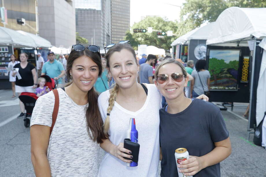 People attend the Bayou City Arts Festival  held downtown Saturday, October 13, 2018 in Houston. Photo: Melissa Phillip, Houston Chronicle / Houston Chronicle