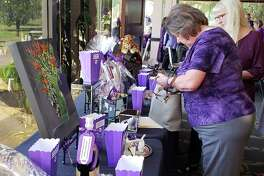 Family Time Crisis & Counseling Center held a raffle during the 7th annual Purple Ribbon Luncheon on Oct. 12, 2018 to help raise funds to build a new shelter.