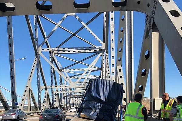 A big rig with a broken trailer Saturday morning shut down one eastbound lane on the Carquinez Bridge causing heavy traffic, officials said.