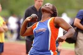 Marsha Locke competes in the shot put