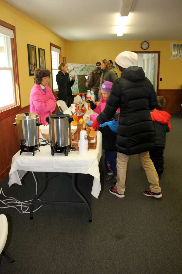 Families line up for some sweet cookies and cider during Saturday's Fall Color Festival at the Huron County Nature Center. Photo: Kate Hessling/Huron Daily Tribune