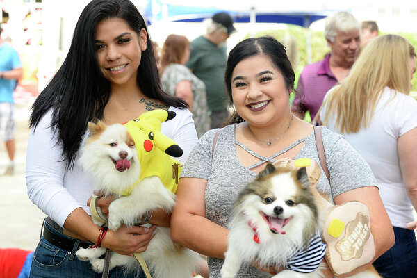 Issys Orellana and Afrania Davila with dogs Beasty and Fendi during Dogtoberfest on Saturday. Photo taken Saturday 10/13/18 Ryan Pelham/The Enterprise