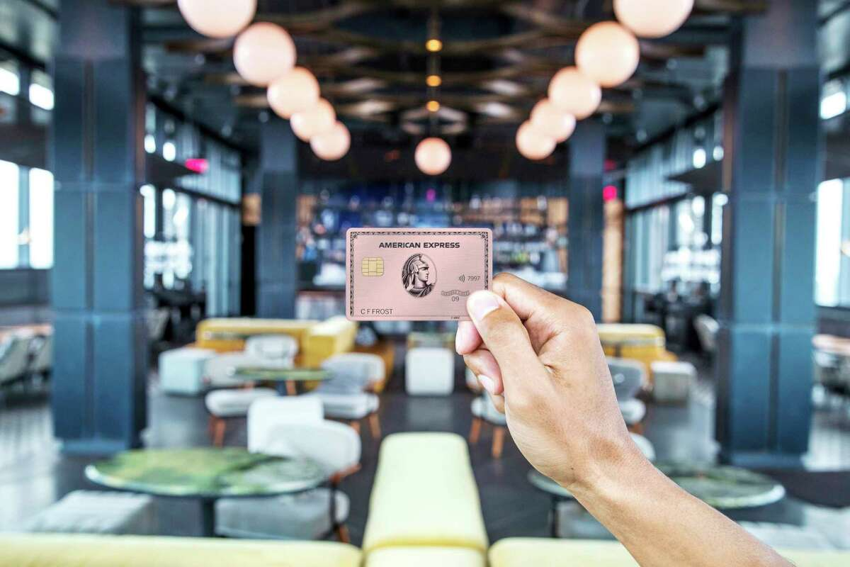 """This undated product image provided by American Express shows the new Gold Card, which is getting a major upgrade this fall. The card will come in stainless steel, like the Platinum Card, and for a limited time, AmEx is offering the card in a ?""""rose gold?"""" tint to those who request it. (Bill Davila/Courtesy of American Express via AP)"""