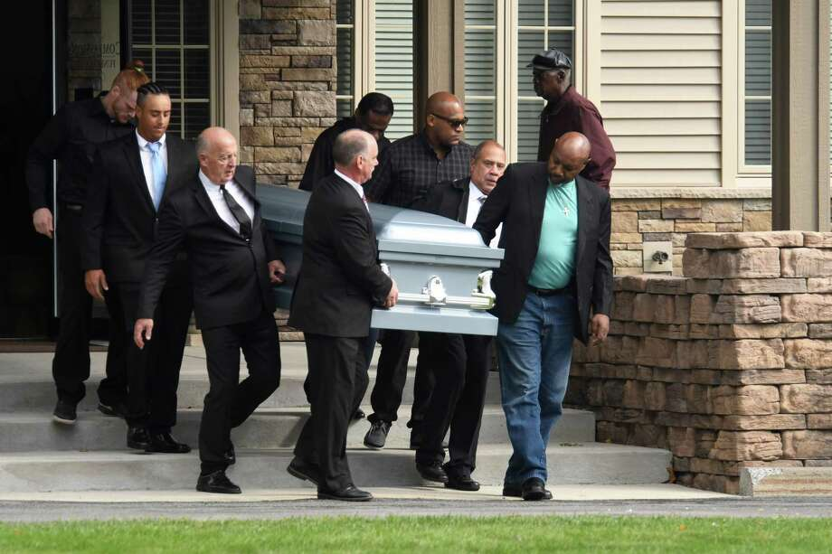 During a funeral service at Compassionate Funeral Care on Saturday, Oct. 13, 2018, in Saratoga Springs, N.Y. pall bearers carry the casket of Scott T. Lisinicchia, 53. He was the driver of the limousine that crashed in Schoharie on Oct. 6, killing him, 17 passengers and two bystanders. (Jenn March / Special to the Times Union) Photo: Jenn March, Jenn March Photography / © Jenn March 2018 © Albany Times Union 2018