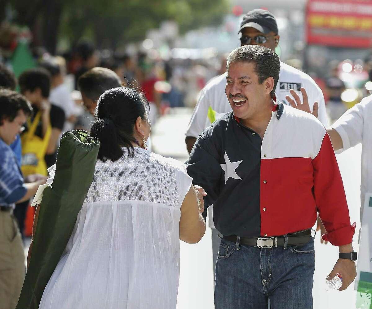 Adrian Garcia shakes hands during the 50th Annual Houston Fiestas Patrias Parade Saturday, Sept. 15, 2018, in Houston.