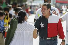 Adrian Garcia shakes hands during the 50th annual Houston Fiestas Patrias Parade on Sept. 15, 2018, in Houston.