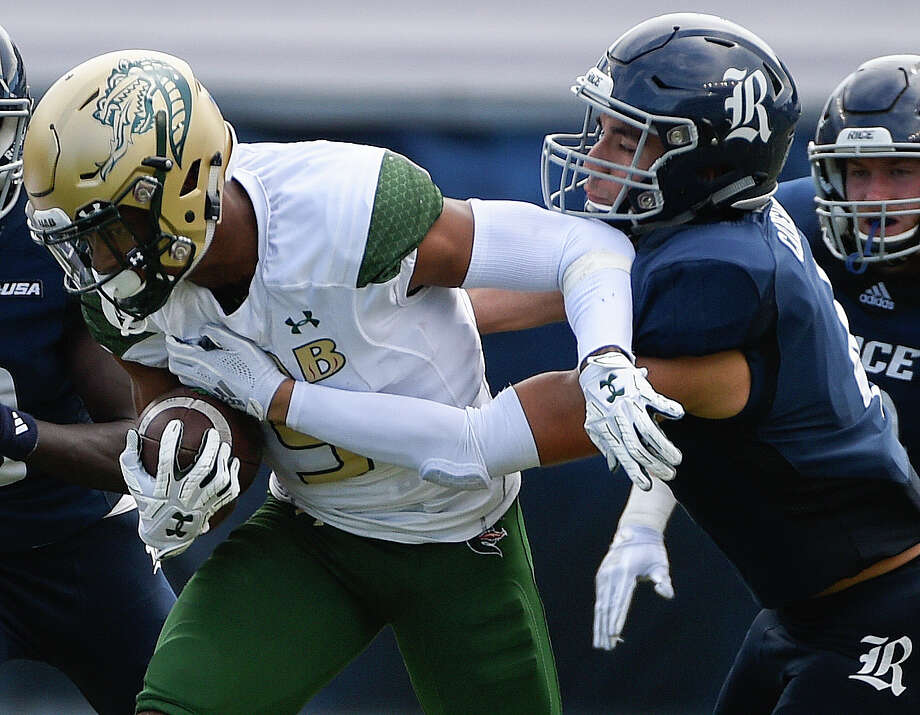 UAB running back Jarrion Street, left, is tackled by Rice defensive back Prudy Calderon during the second half of an NCAA college football game, Saturday, Oct. 13, 2018, in Houston. Photo: Eric Christian Smith, Contributor