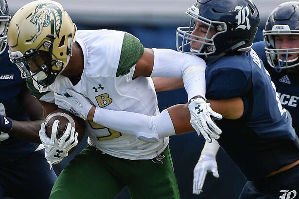 UAB running back Jarrion Street, left, is tackled by Rice defensive back Prudy Calderon during the second half of an NCAA college football game, Saturday, Oct. 13, 2018, in Houston.