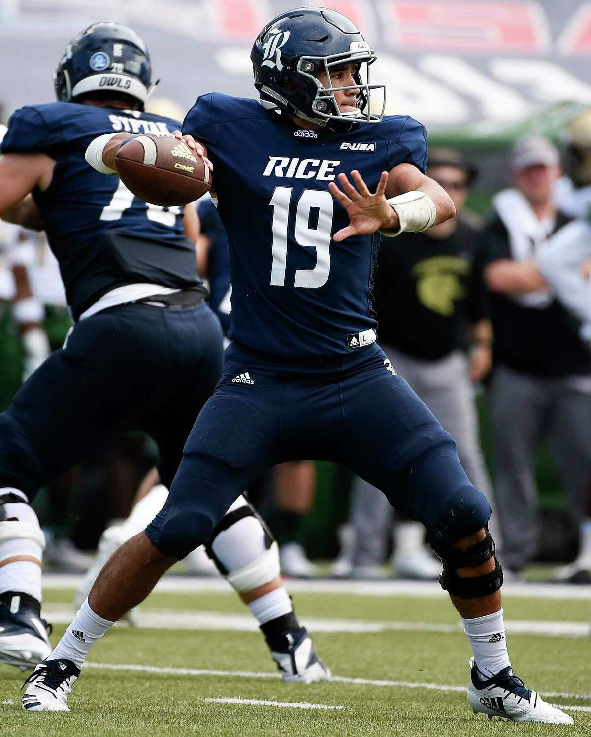 Rice quarterback Evan Marshman drops back to pass during the second half of an NCAA college football game against UAB, Saturday, Oct. 13, 2018, in Houston.
