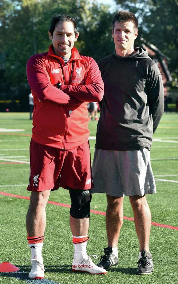 Stratford High School assistant coach Stew Diaz (left) and head coach Ryan Jockers are photographed during soccer practice in Stratford on Friday. Photo: Arnold Gold / Hearst Connecticut Media / New Haven Register