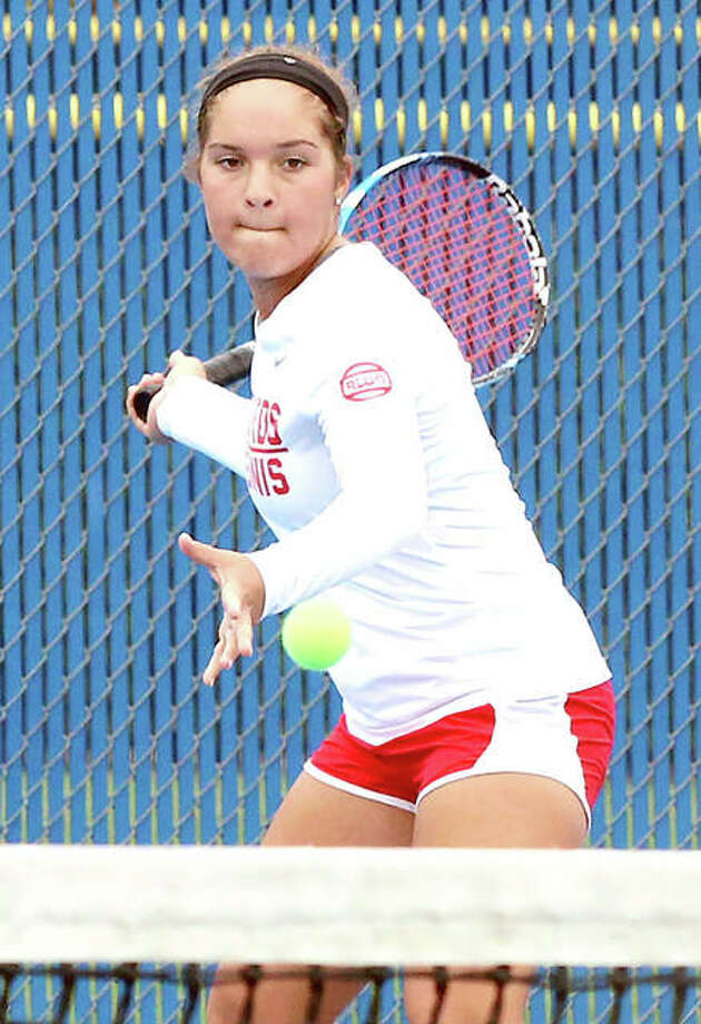 Alton's Hannah Macias returns a shot during her third-place singles match Saturday at the Belleville East Class 2A Sectional in Belleville. Macias finished fourth to become the Redbirds' first state qualifier since 2014. Photo: Greg Shashack | The Telegraph
