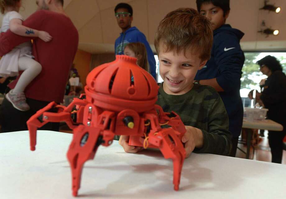 Wilton resident Hugh Cooper controls the robot, Vorpal, The Hexapod, during The Wilton Library's annual Innovation Day Saturday, October 13, 2018, at the library in Wilton, Conn. Innovation Day was a festival of making, creating and demonstrating. Visitors tested virtual reality, rode a hovercraft, experimented with LEDs watched 3D printing and learned craft making at the event. Photo: Erik Trautmann / Hearst Connecticut Media / Norwalk Hour
