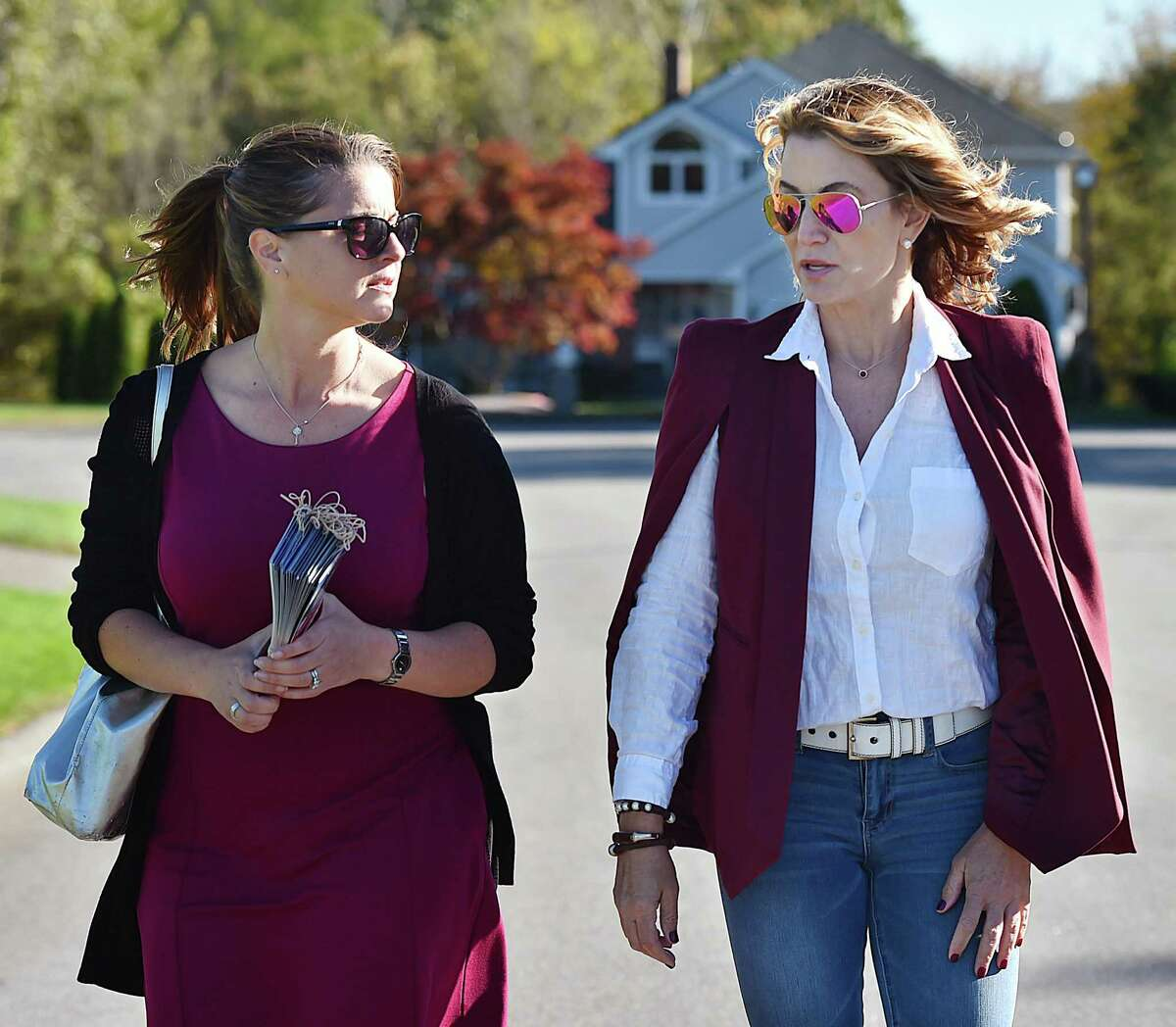 State Rep. Christie Carpino, R-Cromwell, left campaigns door to door with help from her House Minority Leader Themis Klarides, R-Derby Friday, October 12, 2018, in Cromwell.