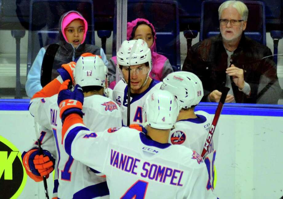 Sound Tigers' Steve Bernier, facing camera, celebrates a second period goal with an assist by teammates Tanner Fritz and Michael Dal Colle during AHL hockey action against Rochester at the Webster Bank Arena in Bridgeport, Conn. on Saturday Oct. 13, 2018. Photo: Christian Abraham / Hearst Connecticut Media / Connecticut Post