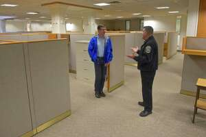 Newtown Police Chief James Viadero talks with Chairman of the Police Commission  Joel Faxon during the department's tour of the old Tauton Press building, 191 South Main Street, which the town hopes to convert into a new police headquarters. Saturday, October 13, 2018, in Newtown, Conn.