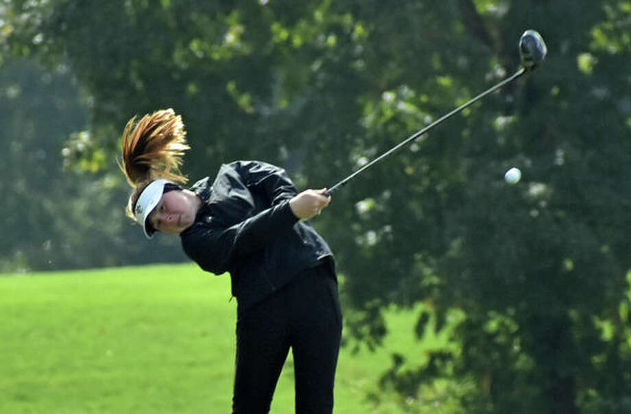 Edwardsville freshman Riley Lewis blasts her tee shot on Hole No. 17 in the Class 2A state tournament at Hickory Point Golf Club in Decatur. Photo: Matt Kamp/Intelligencer