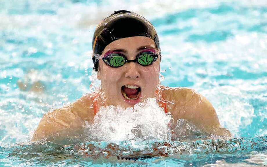Edwardsville's Olivia Ramirez won the 100-yard breaststroke at Saturday's Swim for hope meet at the Chuck Fruit Aquatic Center in Edwardsville. She was one of six EHS individual winners. The Tigers also had three relay wins and finished first in the team race. Photo: Telegraph Photo