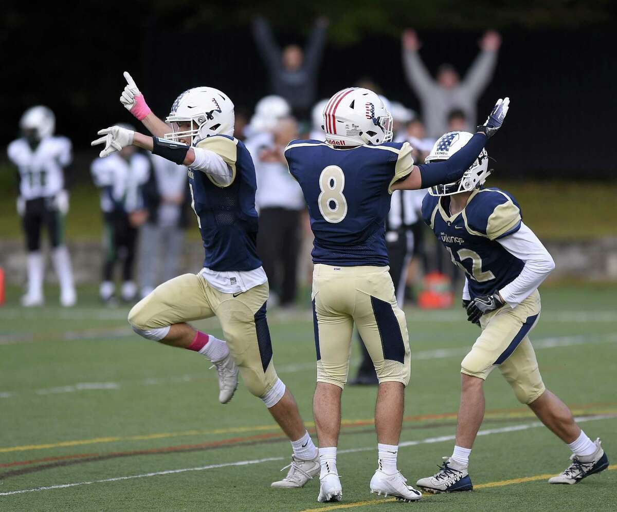King holder Justin Zide (1) celebrates after place kicker Alex Millerchip (42) kicks the game winning extra point against Hamdem Hall in a football game at King School in Stamford, Conn., Saturday, Oct. 13, 2018.