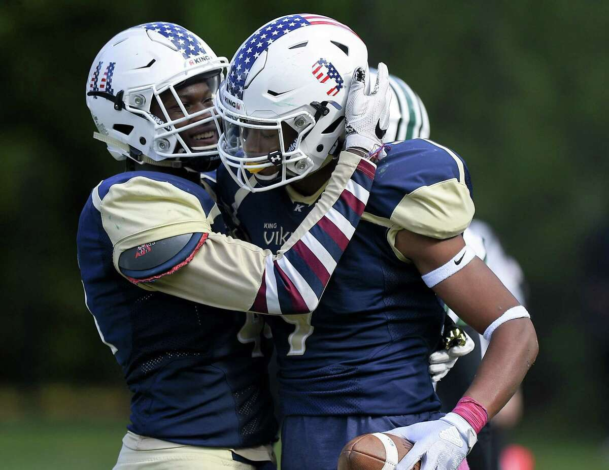 King's Kenny Dyson Jr. (9) celebrates his 4th quarter touchdown against Hamdem Hall with Levaughn Lewis (44) in a football game played at King School in Stamford, Conn., Saturday, Oct. 13, 2018.