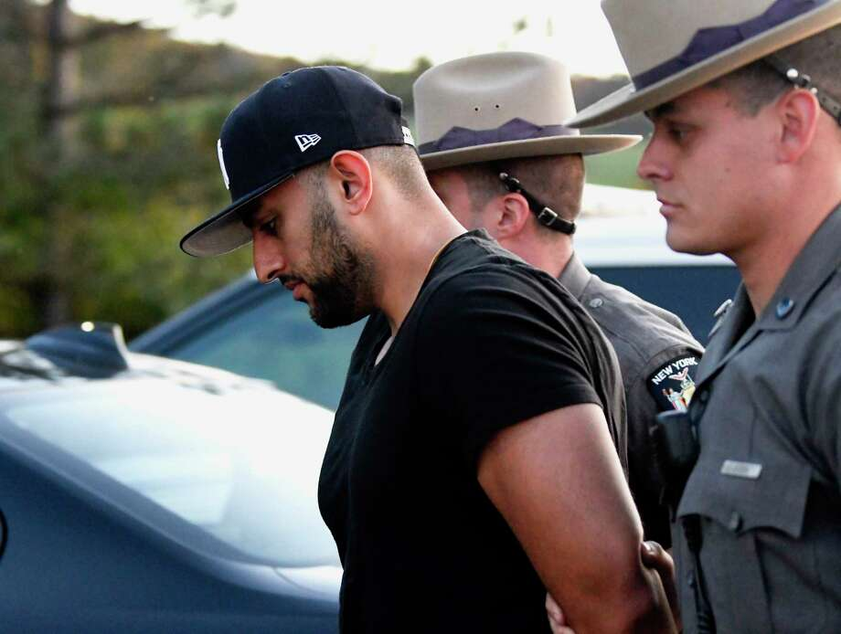 Nauman Hussain is brought into Cobleskill Town Court for his arraignment on Wednesday, Oct. 10, 2018. The limo company operator was charged with criminally negligent homicide in a crash that killed 20 people. (AP Photo/Hans Pennink) Photo: Hans Pennink / Hans Pennink