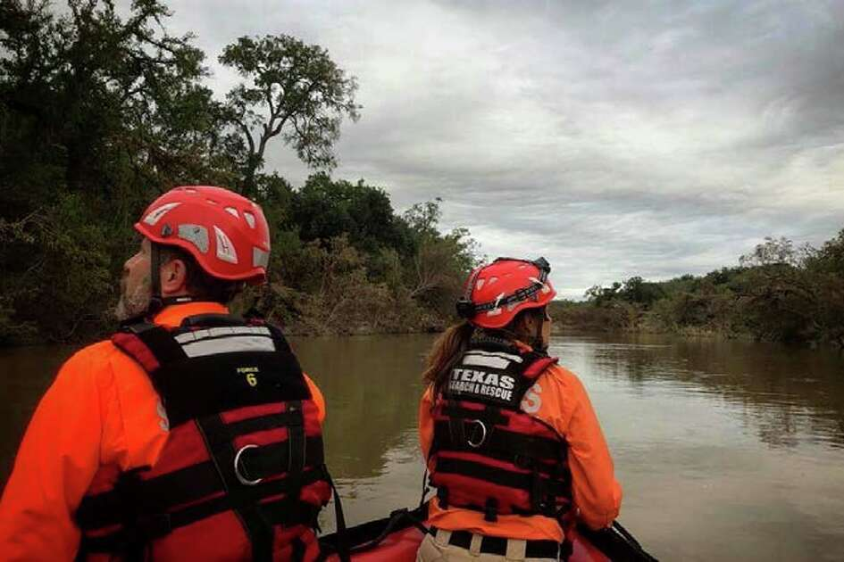 Volunteers continue to search for two missing people Saturday Oct. 13, 2018, in the Junction area after heavy rain Monday caused flooding of the Llano River.