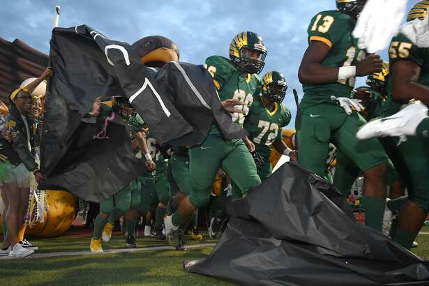 Klein Forest junior linebacker Jorge Sanchez (36) and the Golden Eagles take the field before their District 15-6A matchup with Klein Oak at Klein Memorial Stadium on Oct. 11, 2018.