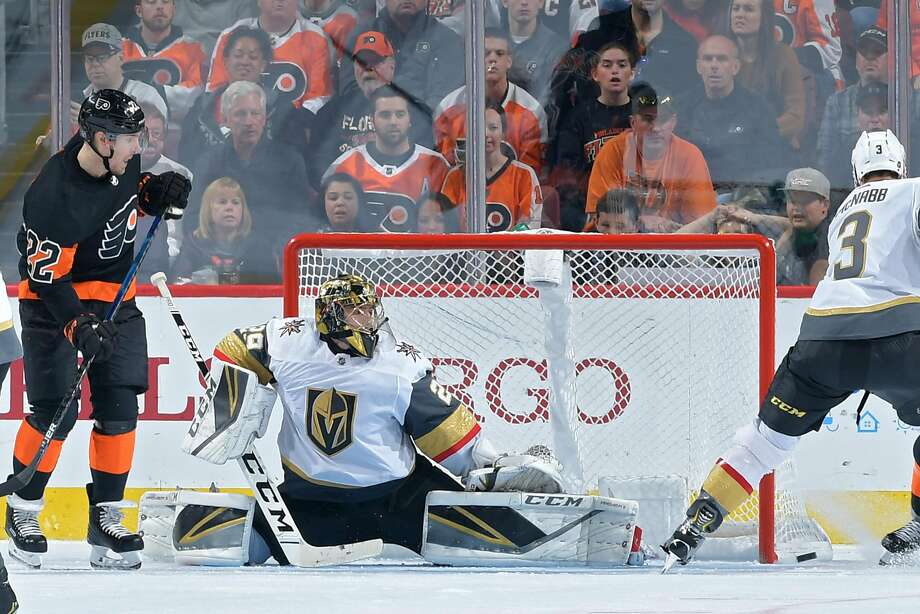 Vegas goalie Marc-Andre Fleury stretches to make a save as Flyers' Dale Weise observes. Photo: Drew Hallowell / Getty Images