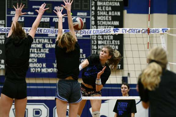 Cy Creek junior outside hitter Alex Evans-Brooks powers a ball at the net during a team practice at CCHS on Oct. 11, 2018.