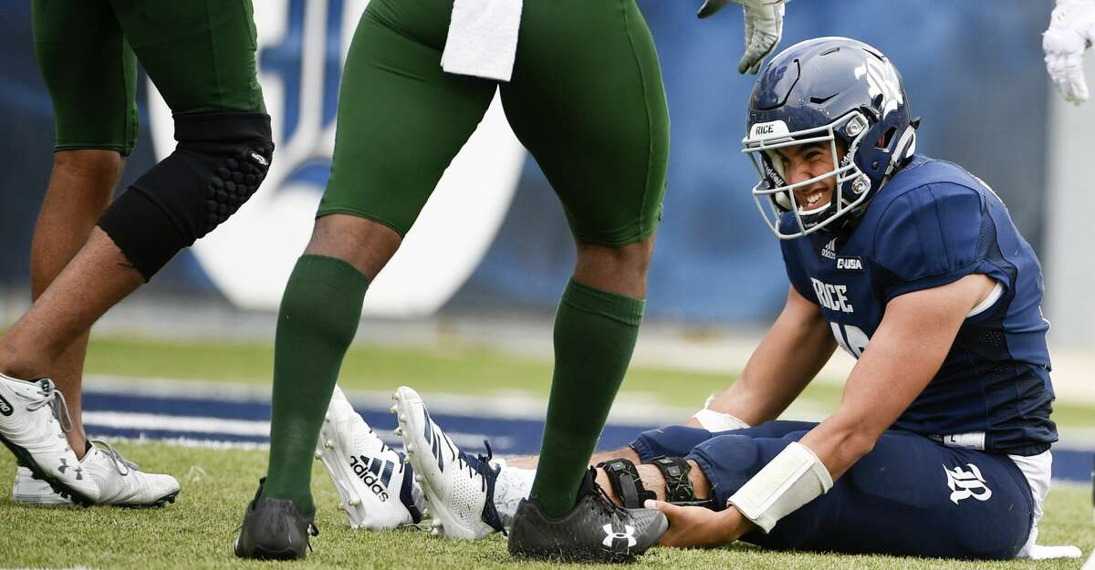Rice quarterback Evan Marshman winces after being sacked and fumbling the ball during the second half of an NCAA college football game against UAB, Saturday, Oct. 13, 2018, in Houston. (Eric Christian Smith/Contributor)