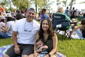 Reed and Alena Nilles with baby Rylan at Oktoberfest at Rogers Park on Saturday.   Photo taken Saturday 10/13/18  Ryan Pelham/The Enterprise