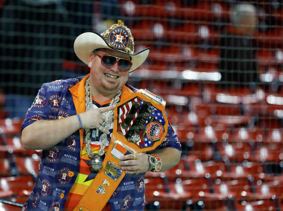 An Astros fan is bedecked in Astros gear, including a grill, before Game 1 of the American League Championship Series at Fenway Park on Saturday, Oct. 13, 2018, in Boston.