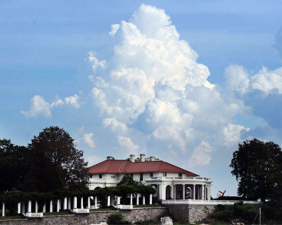 Clouds form over the mansion at the tip of Indian Harbor Point in Greenwich in 2014. The plan to eliminate the state income tax by Bob Stefanowski, the Republican candidate for governor, would deliver a sunny $2.4 billion giveback to the highest-income 4,000 households in Connecticut. Photo: Bob Luckey / Hearst Connecticut Media / Greenwich Time