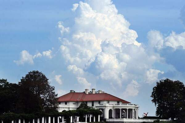 Clouds form over the mansion at the tip of Indian Harbor Point in Greenwich in 2014. The plan to eliminate the state income tax by Bob Stefanowski, the Republican candidate for governor, would deliver a sunny $2.4 billion giveback to the highest-income 4,000 households in Connecticut.
