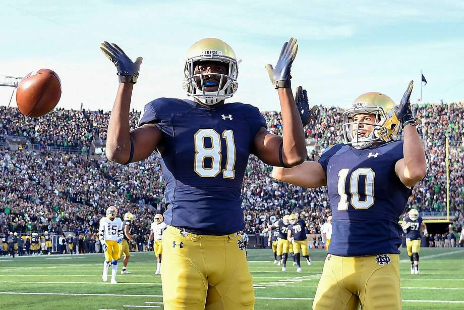Miles Boykin (left) reacts with Chris Finke #10 after scoring the touchdown to give Notre Dame the lead against the Pittsburgh in South Bend, Ind. Photo: Quinn Harris / Getty Images