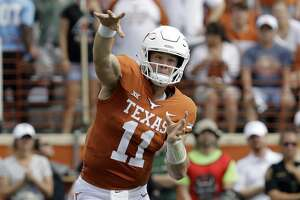 Texas quarterback Sam Ehlinger (11) throws against Baylor during the first half of an NCAA college football game, Saturday, Oct. 13, 2018, in Austin, Texas. (AP Photo/Eric Gay)