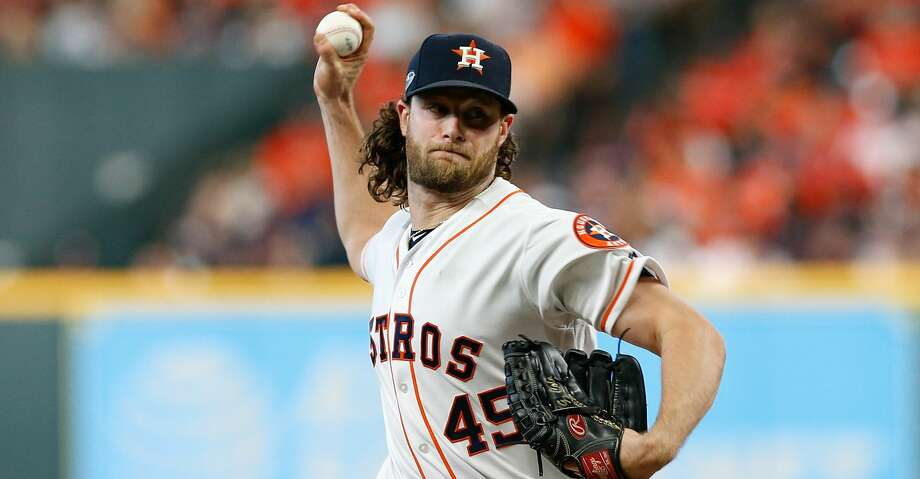 HOUSTON, TX - OCTOBER 06:  Gerrit Cole #45 of the Houston Astros delivers a pitch in the seventh inning against the Cleveland Indians during Game Two of the American League Division Series at Minute Maid Park on October 6, 2018 in Houston, Texas.  (Photo by Tim Warner/Getty Images) Photo: Tim Warner/Getty Images