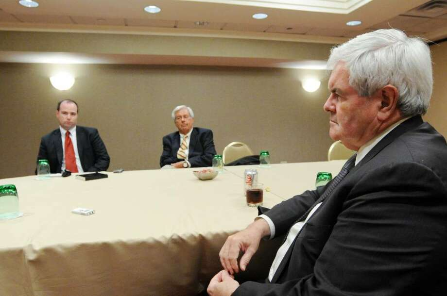 Former Speaker of the House Newt Gingrich sits with America Solutions press secratery RC Hammond, left, and political consultant Joe Gaylord as he prepares for a Town Hall meeting bringing his citizen-action group American Solutions to the Stamford Marriott Wednesday, July 14, 2010. American Solutions is a citizen action network aimed at resolving the problems facing America today. Gingrich led a Town Hall meeting focused on topics including jobs and healthcare. Photo: Keelin Daly / Stamford Advocate