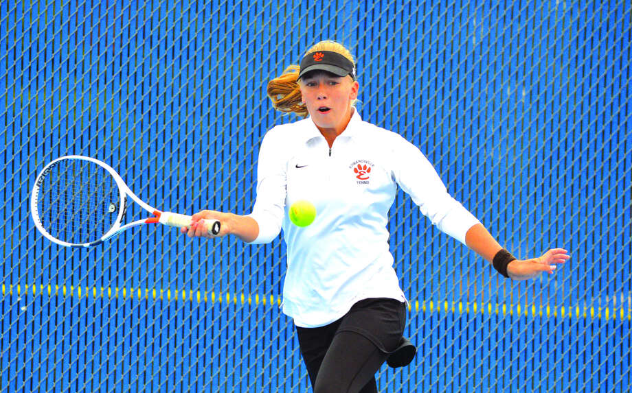 Edwardsville freshman Hannah Colbert makes a forehand return on Saturday during her third-place doubles match with partner Annie McGinnis at the Class 2A Belleville East Sectional. Photo: Scott Marion